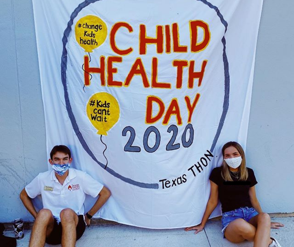 Kids in front of child health day 2020 banner.